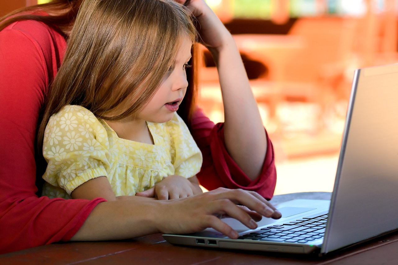 girl learning kids coding language with her mother