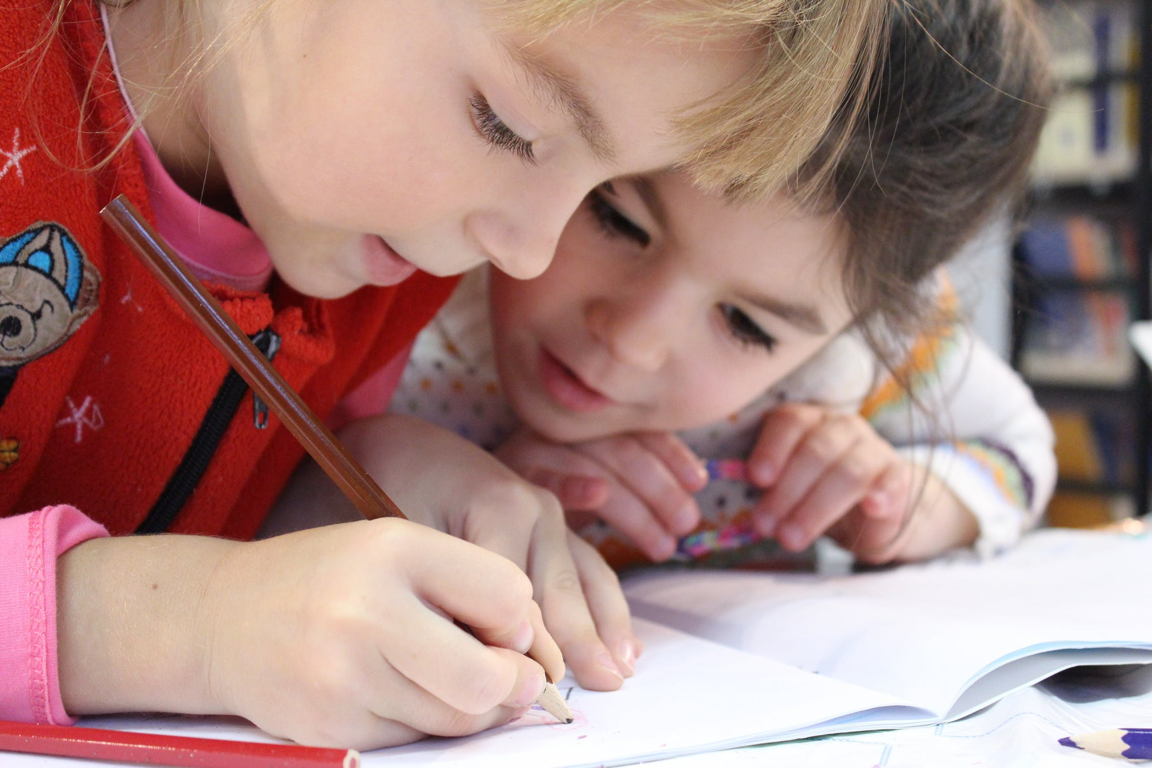 two kids writing