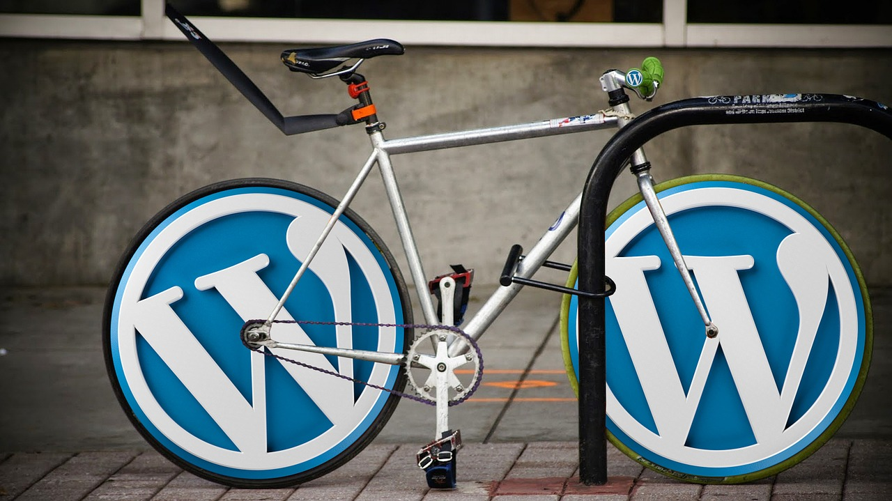 WordPress logo on a bicycly